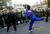 April 9 2005 A protestor throws a rock at the Japanese Embassy Photo Greg Baker