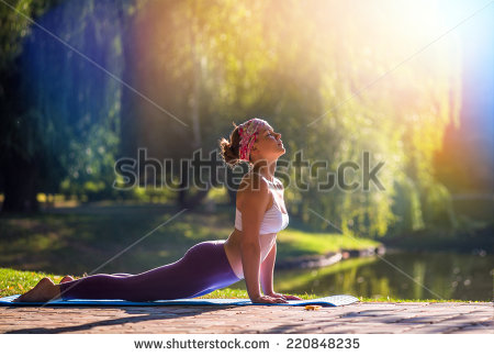 stock-photo-young-woman-doing-yoga-in-morning-park-220848235