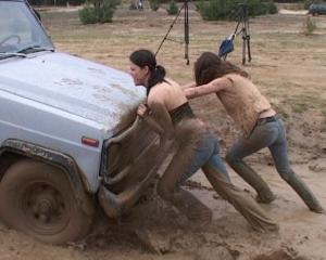 http://www.madmanmovies.com/images/gross/car_stuck_girls_ridingboots_mud_024-new.jpg
