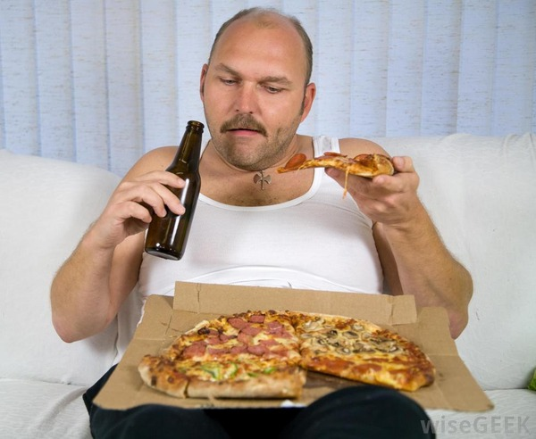 overweight-man-eating-pizza-and-drinking-beer-on-couch