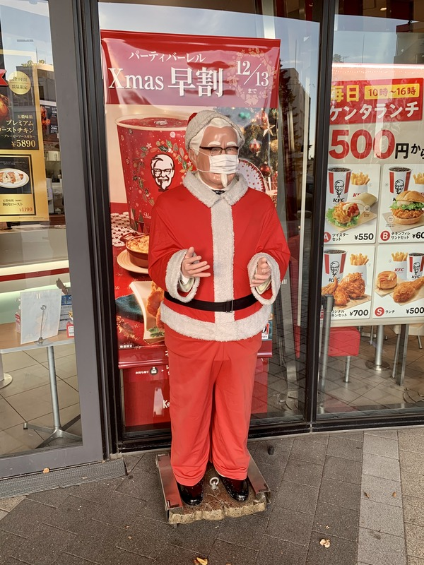 Colonel_Sanders,_wearing_a_mask