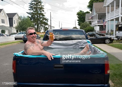 173945034-redneck-swimming-pool-man-relaxing-in-pick-gettyimages
