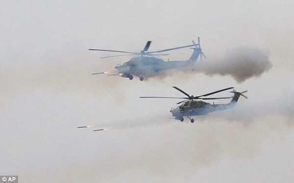 447317FE00000578-4898492-Russian_military_helicopters_fire_